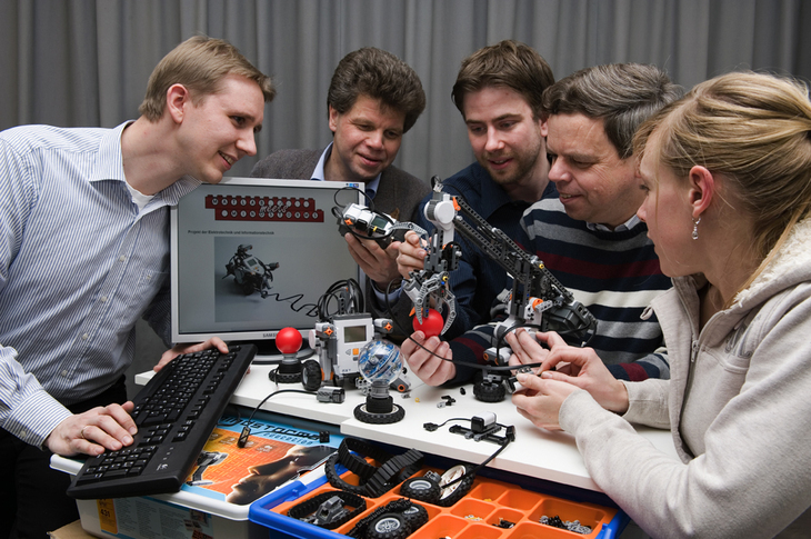Group of researchers with a robot