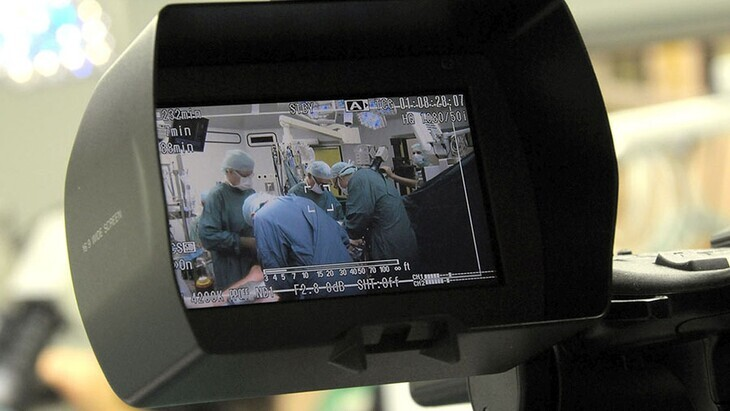 Looking at an operation through a camera viewfinder