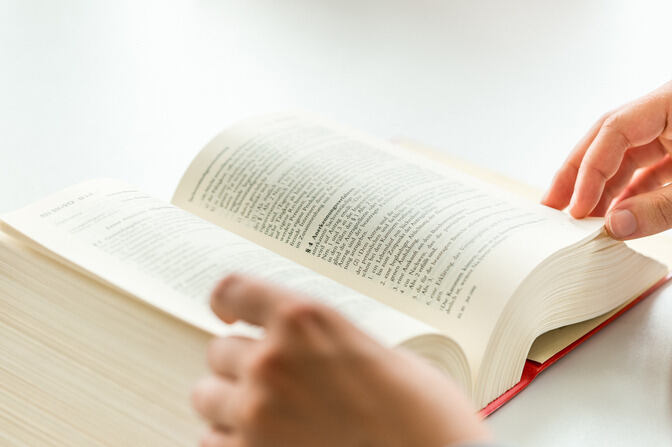 A person's leafing through an open book