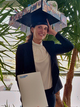 Anne Maria Wallraf with her PhD hat and certificate