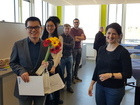 Dr. Leticia Novaes hands over the present to Zhi from the Schwaneberg group