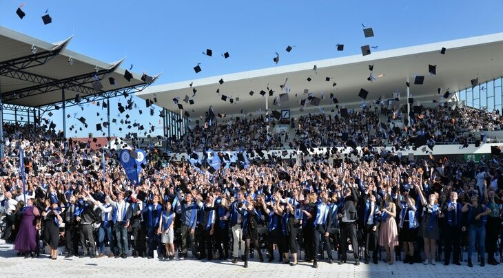 graduates throwing their caps in the air