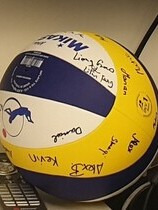 Gustavo's present: a beachvolleyball with signatures of the group coworkers