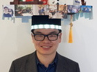 Dr. Zhi Zou wearing his PhD hat