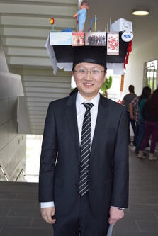 Photo of Dr. Zhanzhi Liu with hat